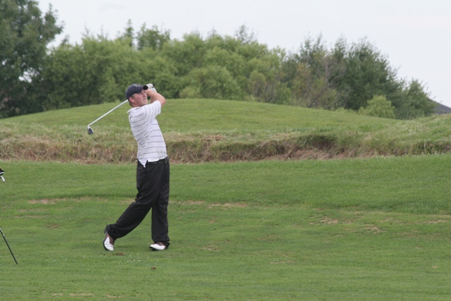 image of man playing golf